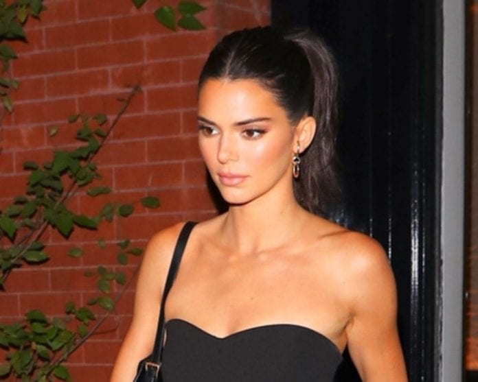 Kendall-Jenner-shows-off-her toned figure in form-fitting-black-romper