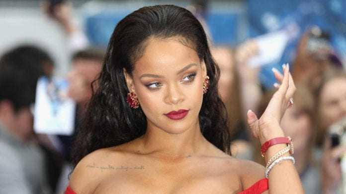 Rihanna Gives Us The Christmas Gift of Life Modeling Red-Savage-X-Fenty-Loungewear